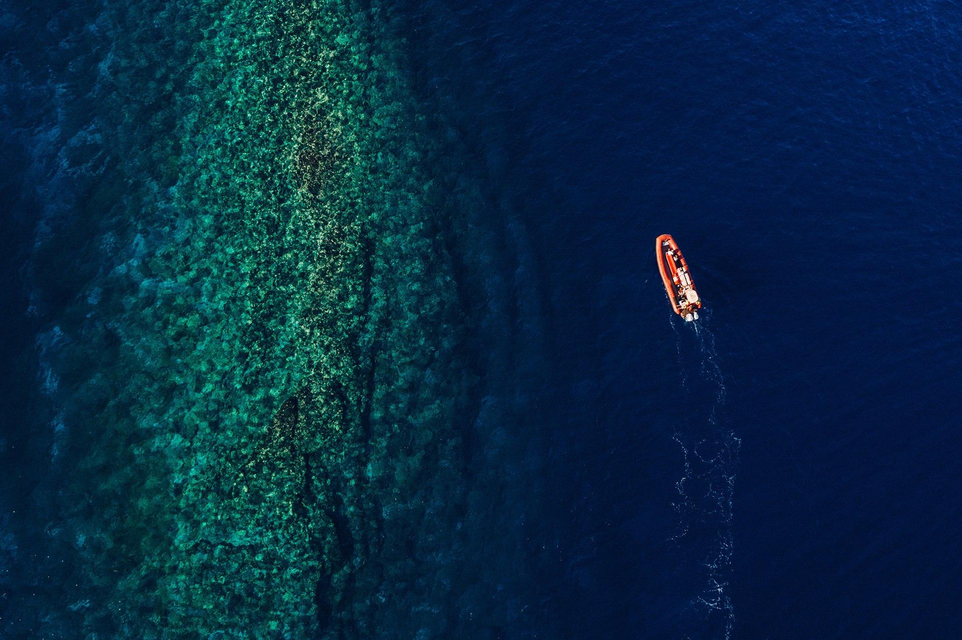 Redline Boat on The Ocean Pic